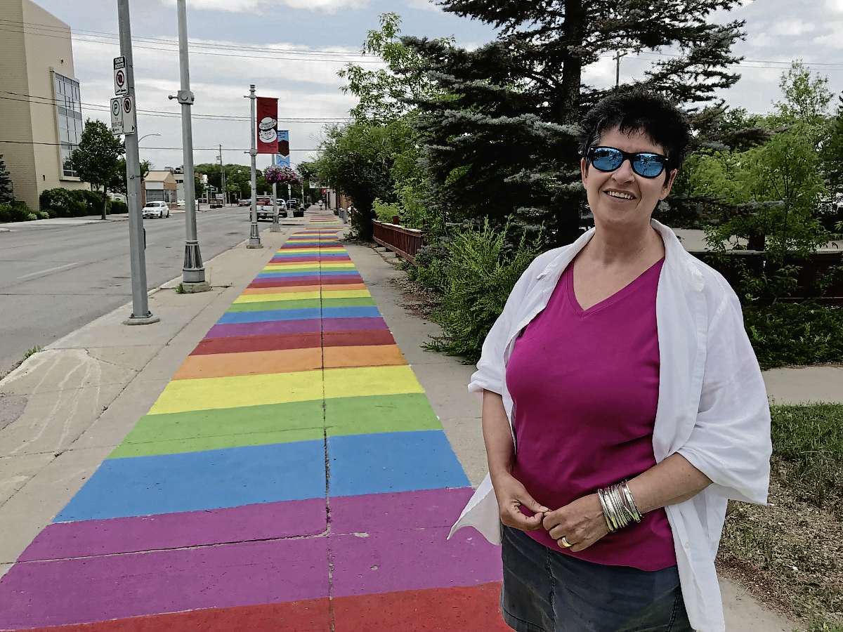 """Alex Morrison, executive director of the Transcona BIZ, said the new Welcome Mats sidewalk murals are intended to invite people to """"follow the rainbow to the pot of gold"""" that is Transcona's downtown. (SHELDON BIRNIE/CANSTAR/THE HERALD)"""