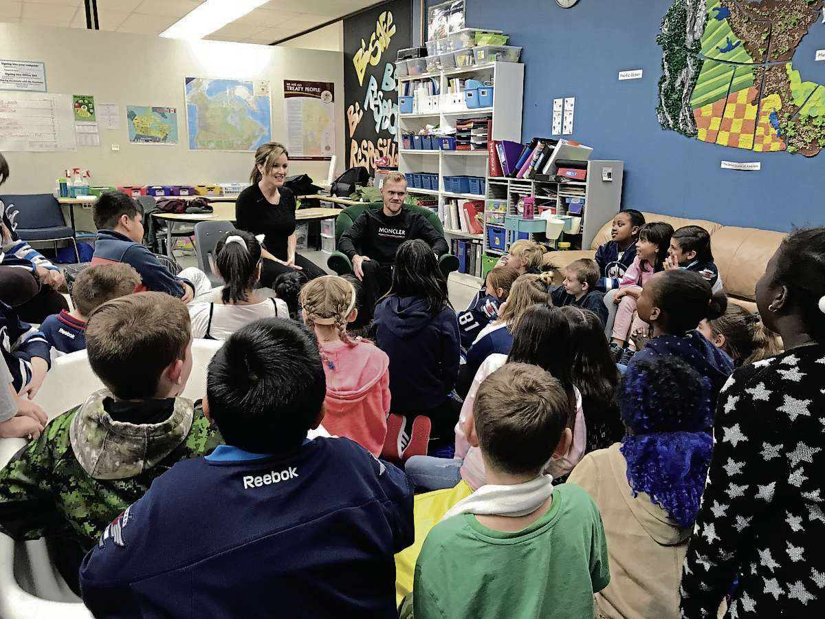 """Suzi Friesen, director of educational programs with the True North Foundation, and Ehlers practiced a """"mindful moment"""" with Grade 4 and 5 students. One of the outcomes of Project 11 is to teach students different ways to cope with stress. (SHELDON BIRNIE/CANSTAR/THE HERALD)"""
