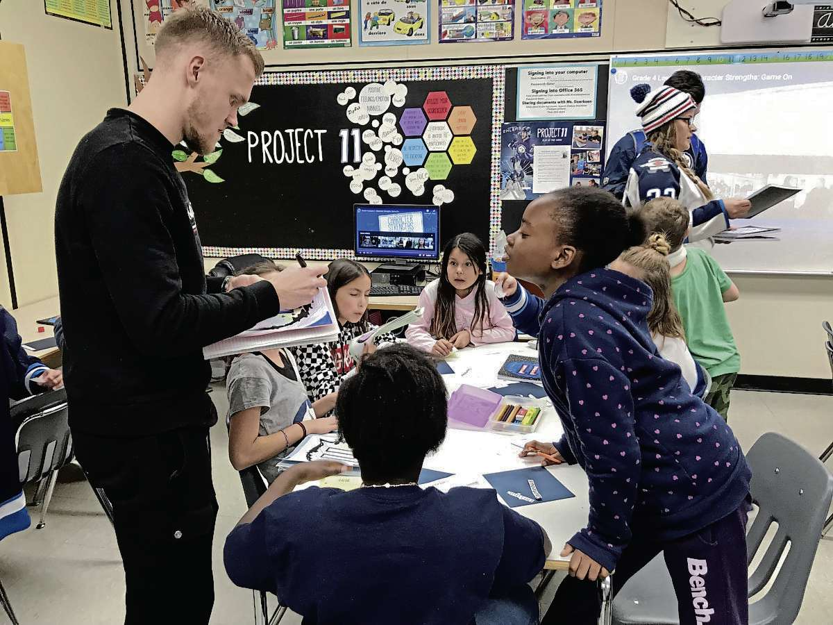 Ehlers took time to sign autographs and check in on the work students at Bertrun E. Glavin School were doing as part of the Project 11 curriculum. (SHELDON BIRNIE/CANSTAR/THE HERALD)