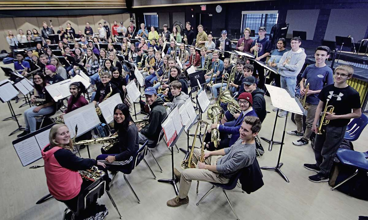 "The ""no cut"" River East Collegiate jazz band has over 100 members, including 30 saxophones, 17 trumpets, 15 percussions and more. The whole band will perform at the school's Dec. 6 winter concert."