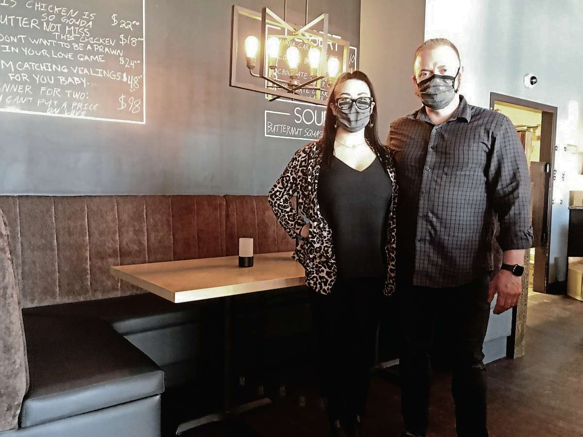 Jillian Flynn and Danny Van Lancker, owners of Rae's Bistro & Lounge, are happy to welcome customers back in to dine at their restaurant. (SHELDON BIRNIE/CANSTAR/THE HERALD)