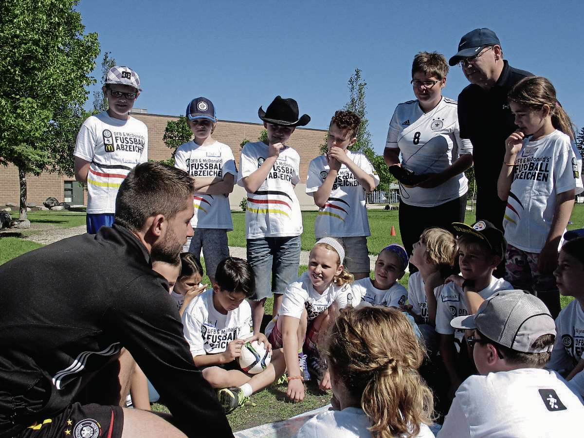 June 18, 2015 - Oliver Fiest (left), a visiting Auf Ballhohe soccer coach from Munich, Germany, quizzes a group of Grade 4 German Bilingual program students at Princess Margaret School. (SHELDON BIRNIE/CANSTAR COMMUNITY NEWS/THE HERALD)
