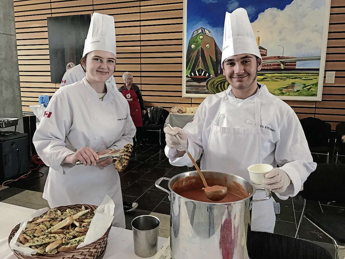Veydtta Miller (left) and Mason Kamal, two students from John G. Stewart School, took part in Stone Stoup, an annual fundraiser put on by the Child Nutrition Council of Manitoba. Miller and Kamal helped cook a tomato and bacon bisque, then served it up to hungry donors as part of Stone Soup's annual fundraiser, which doubles as a soup competition among some of the city's top chefs. (SHELDON BIRNIE/CANSTAR/THE HERALD)