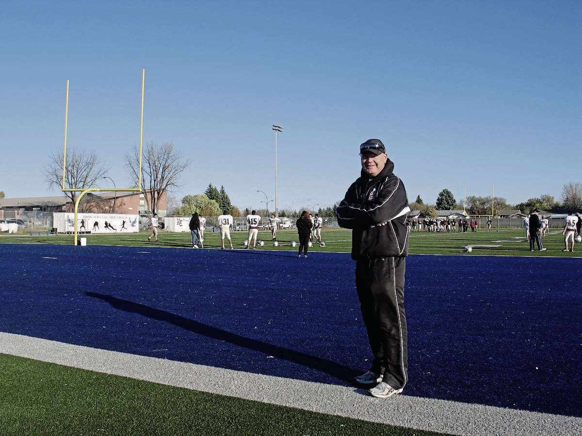Kildonan East Collegiate head football coach Jason Hawkins takes a moment out from practice to talk about the program's upcoming 10 year anniversary banquet. (SHELDON BIRNIE/CANSTAR/THE HERALD)