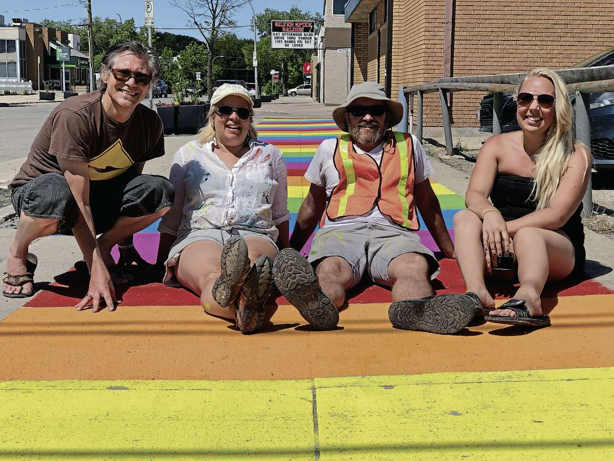 (From left) Artists Darryl Neufeld, Glenna Evans, James Culleton, and Rachel Lancaster worked on the three Welcome Mats sidewalk murals that were painted along Bond Street on July 4 and 5. The murals are a BIZ initiative to get people visiting and talking about downtown Transcona.