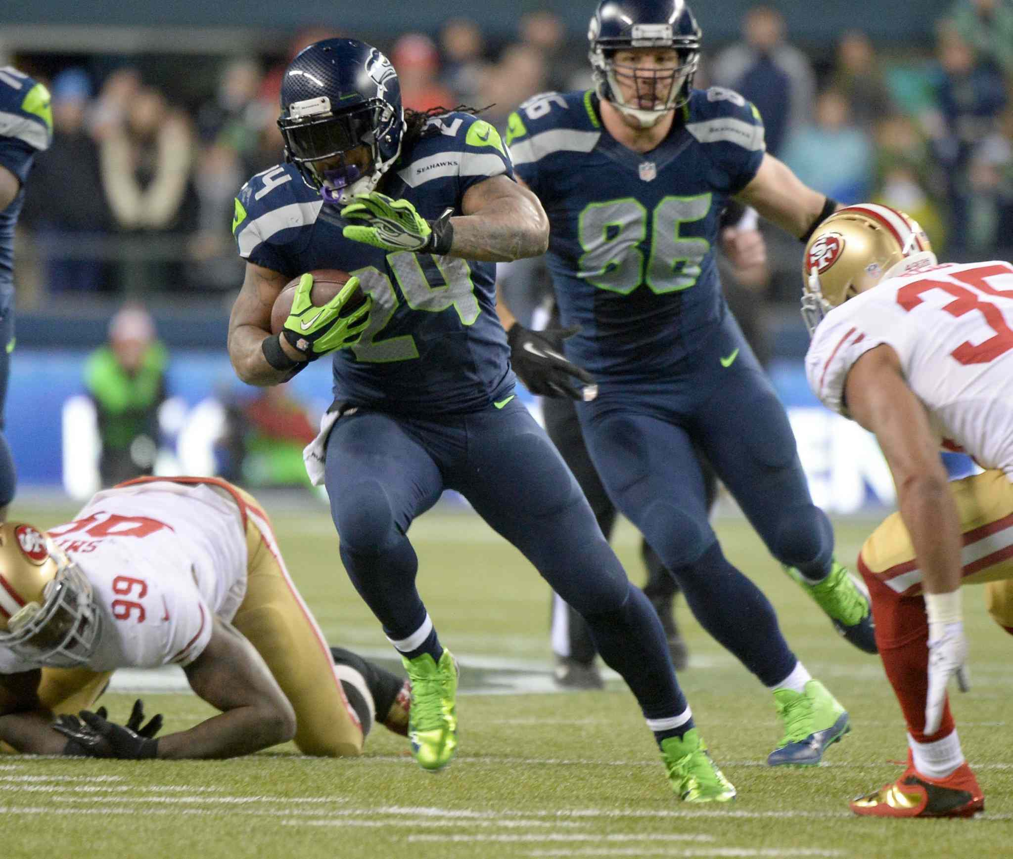 Seahawks running back Marshawn Lynch breaks for open ground on a 40-yard touchdown run.