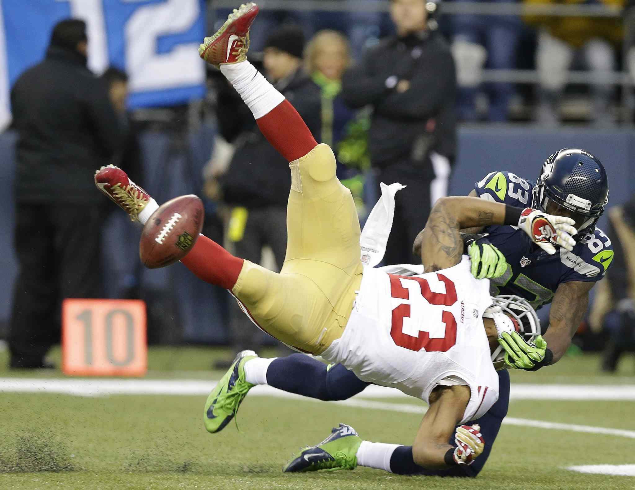 49ers' LaMichael James fumbles as he is hit by Seahawks Ricardo Lockette.