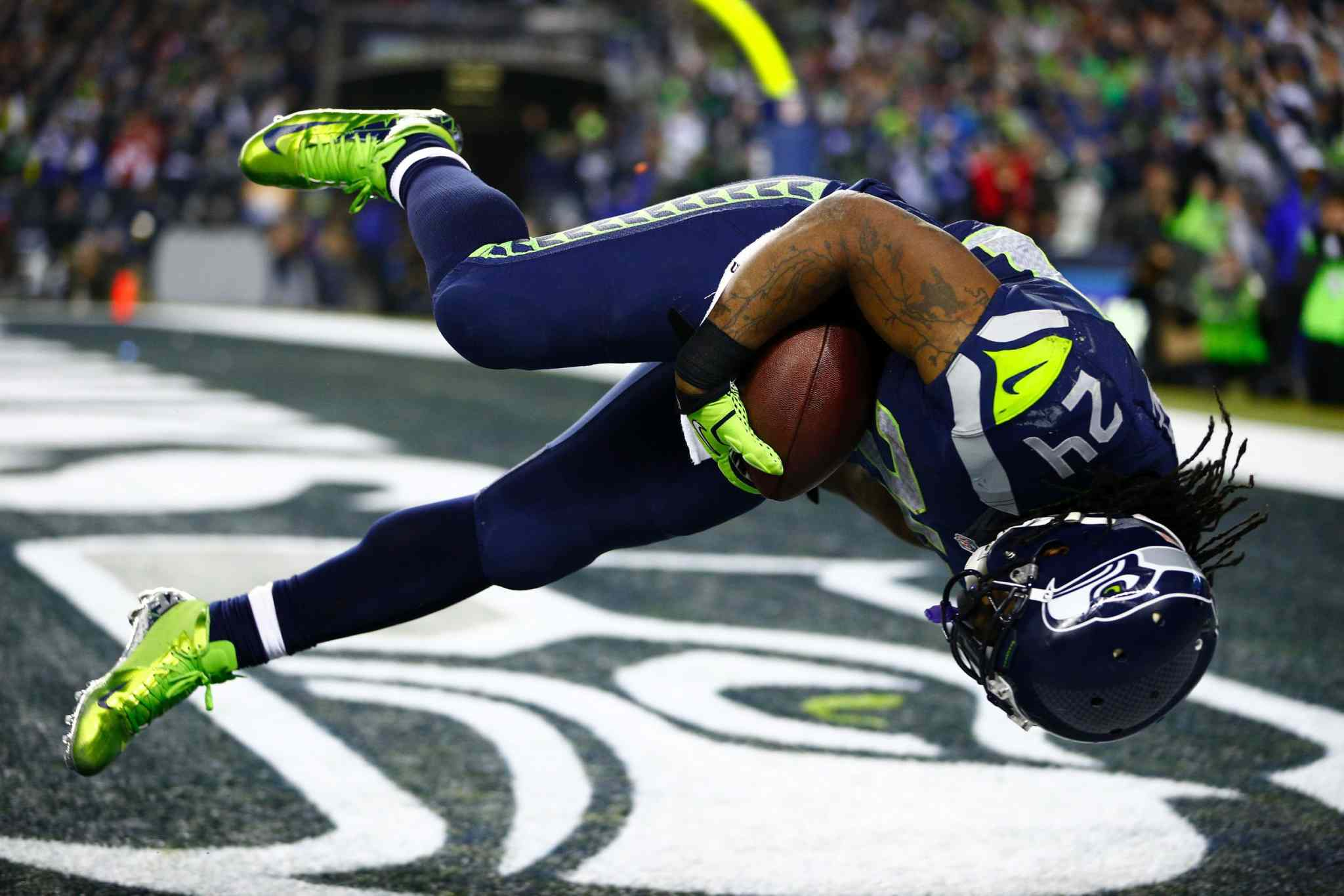Seahawks running back Marshawn Lynch dives in to the end zone for a touchdown during the second half of the NFC championship.