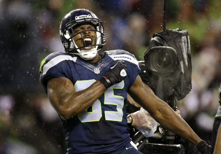 Seattle Seahawks' Anthony McCoy reacts after scoring against the San Francisco 49ers late in the first half of an NFL football game Sunday in Seattle. Seahawks won 42-13.