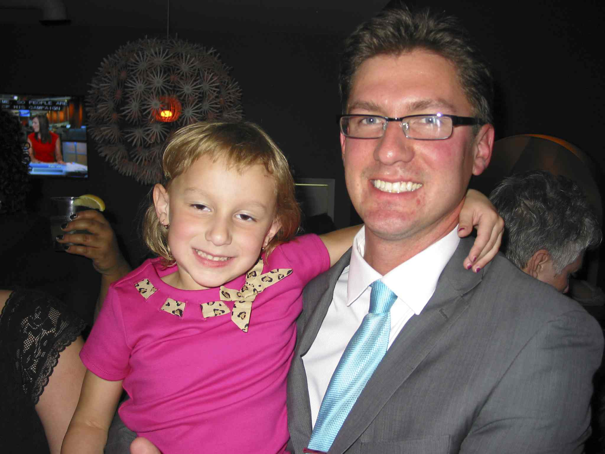 Matt Allard, newly elected city councillor for St. Boniface, holds his daughter Camille, 5, at his election night celebration.
