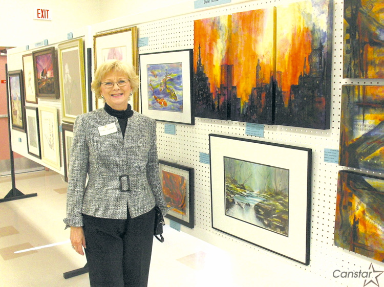 Dale Turner seen showcasing some of her paintings at a previous exhibition.