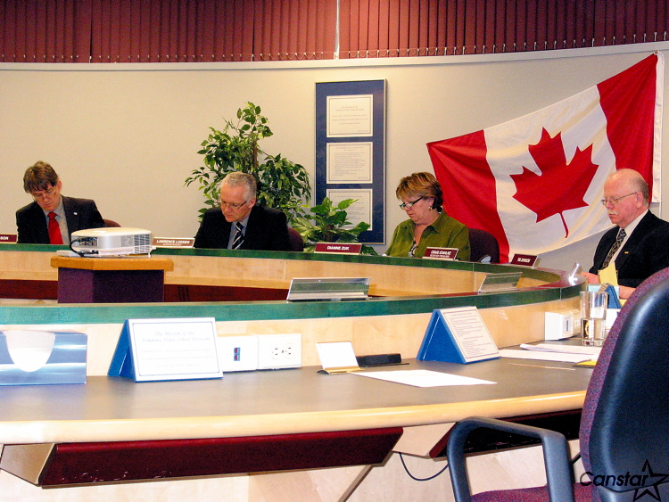 From left to right: David Johnson, vice-chair of the board of trustess; Lawrence Lussier, PSTD's superintendent; Dianne Zuk, board chair and Craig Stahlke, PTSD's secretary treasurer, survey the new budget on March 10.
