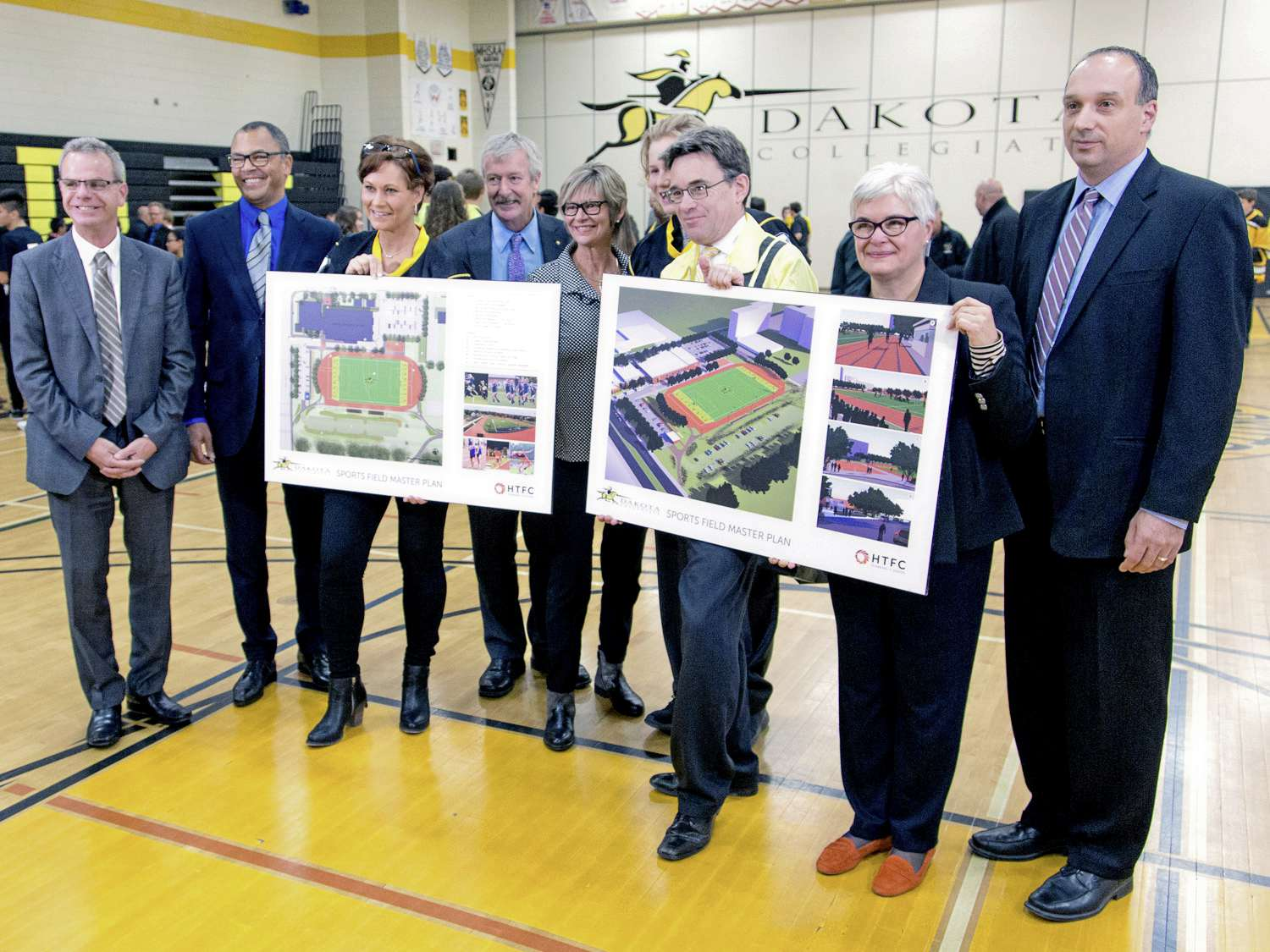 From left: MLA for Fort Garry-Riverview James Allum; Louis Riel School Division superintendent Duane Brothers; MLA for Seine River Theresa Oswald; president of Dakota Alumni Association Les Wiens; MLA for St. Vital Nancy Allan; Grade 10 student Reid Vankoughnett; Coun. Brian Mayes (St. Vital); MLA for Riel Christine Melnick; and head of the school's math department Dean Favoni, who also has two children at the school.