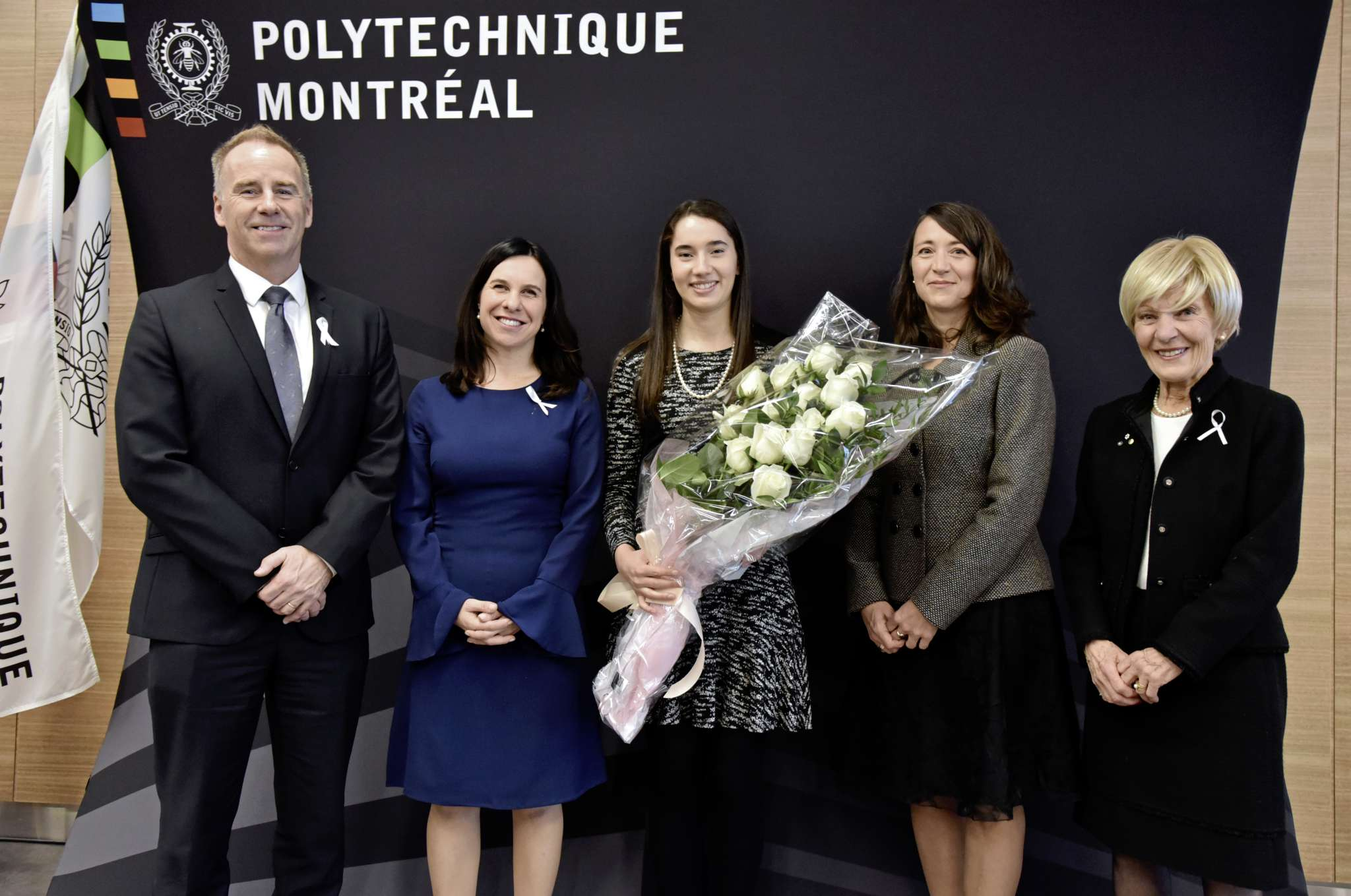 """(From left) François Bertrand, Polytechnique Montréal's interim CEO and chief research, innovation and international officer; Valérie Plante, Mayor of Montréal; Ella Thomson; Nathalie Provost, who was injured in the 1989 tragedy at the school and is """"Godmother"""" of the Order of the White Rose; and Michèle Thibodeau-DeGuire, principal and chair of the board of directors of Polytechnique Montréal, who is also president of the Order of the White Rose jury."""