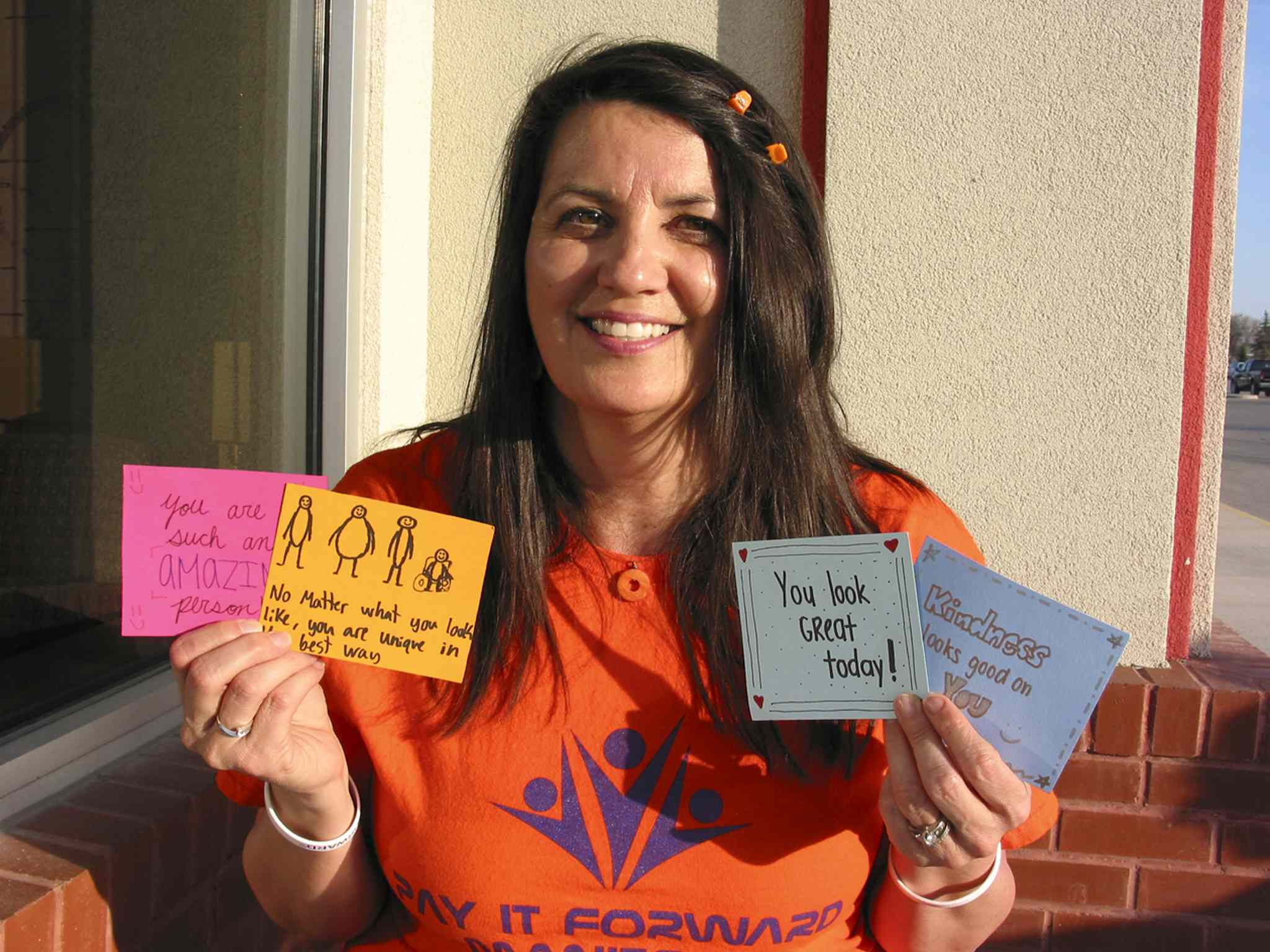 Yvette Deveau holds some of the handwritten notes given out on April 30.