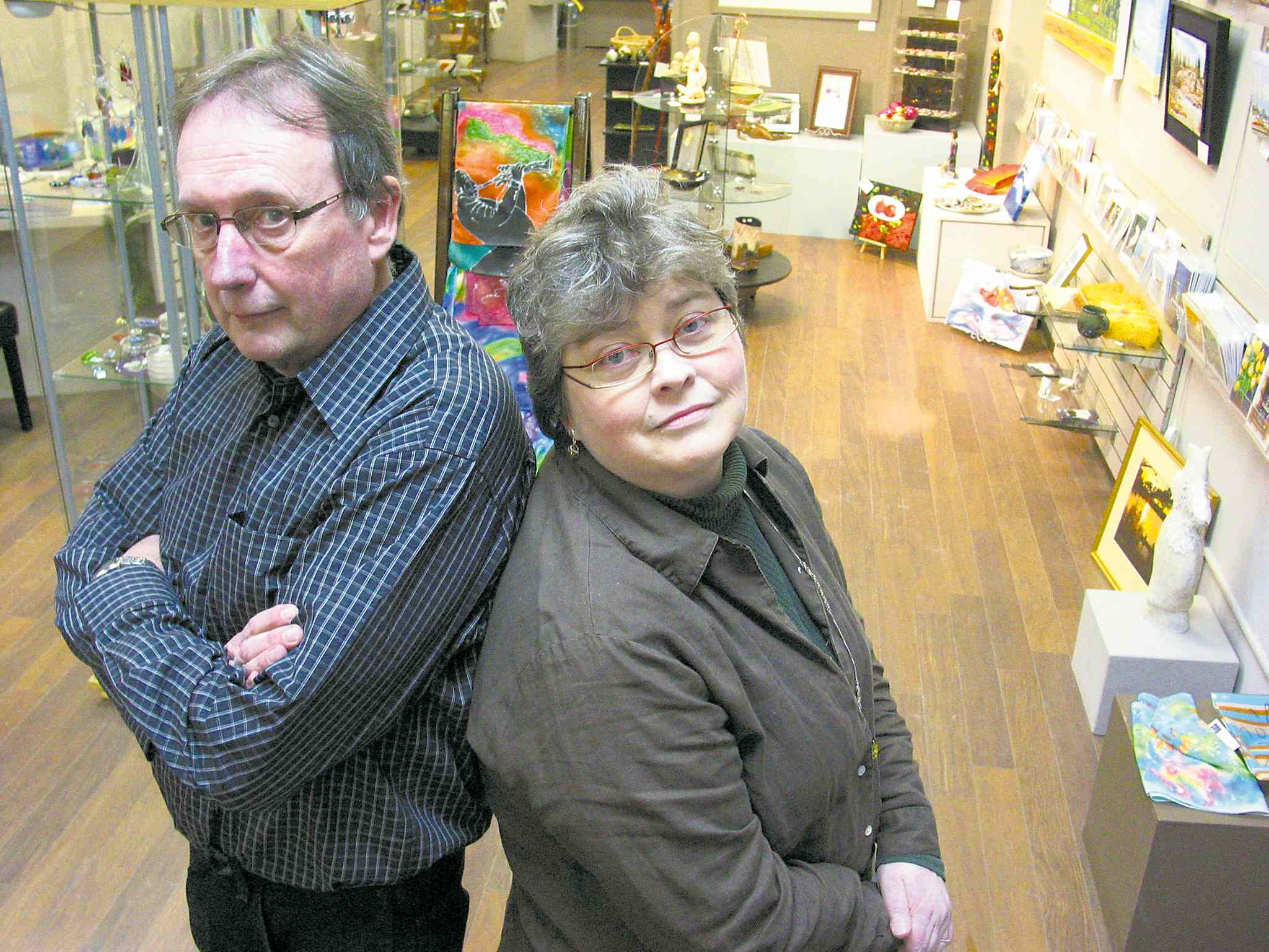 In this January 2012 file photo at Medea Gallery, then-president George Tanner (left) and member Kathleen Black had concerns about the location's future due to declining membership. Members of the gallery have decided to close its doors after 35 years to regroup and rethink before beginning the search for a new home.