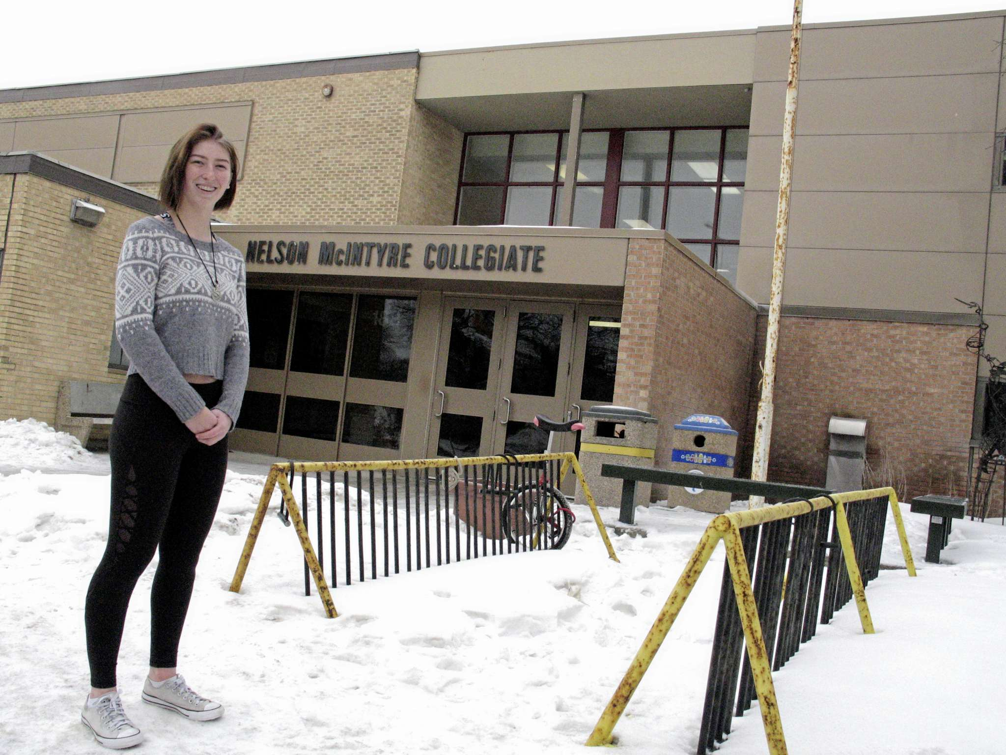 Danika Harland outside Nelson McIntyre Collegiate. The Southdale resident's design will transform the school's courtyard area (not pictured), which will include a number of vertical bike racks. (SIMON FULLER/CANSTAR NEWS/SIMON FULLER)