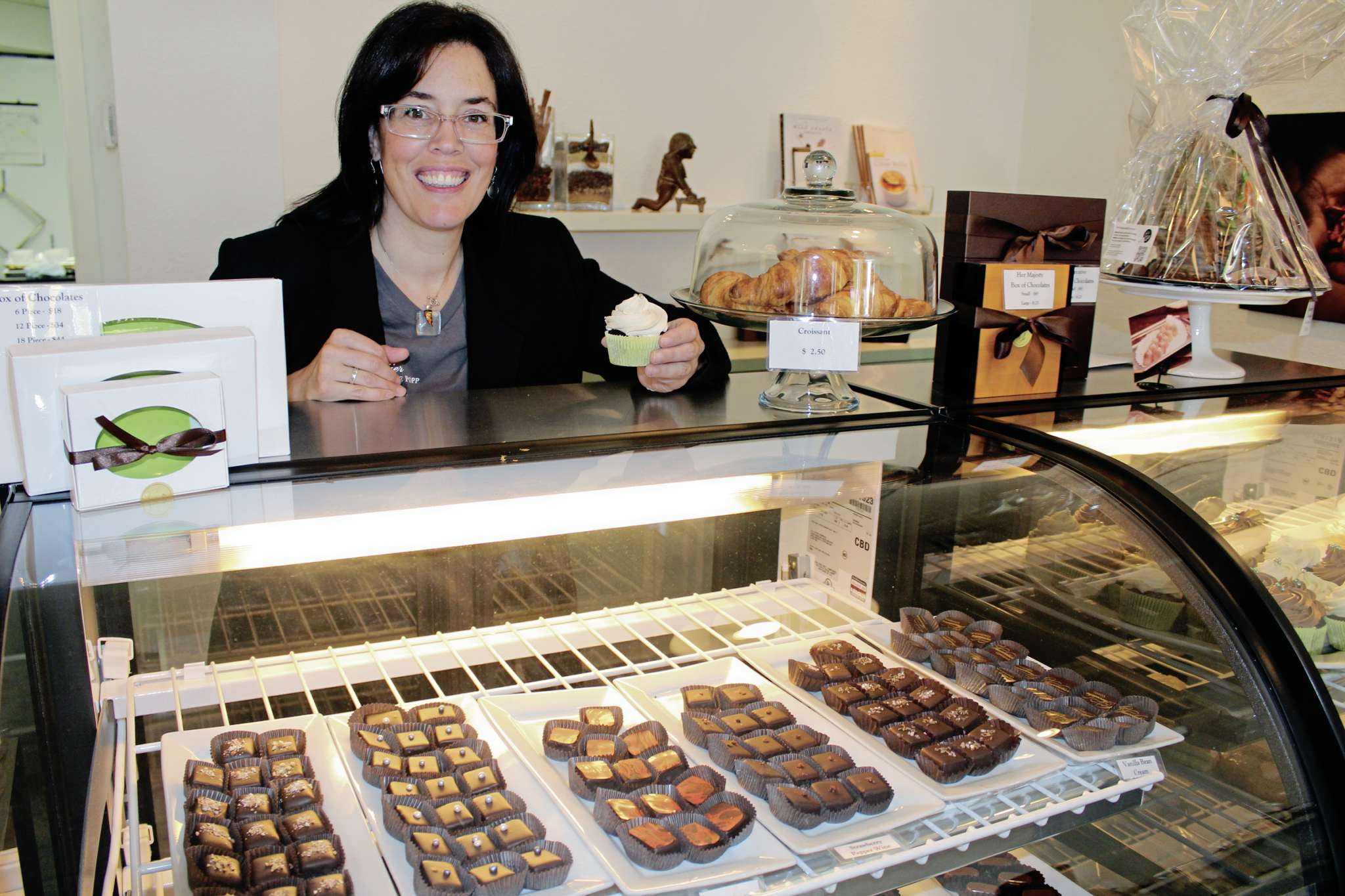Constance Menzies, pictured here at Chocolatier Constance Popp (180 Provencher Blvd.), is creating chocolates celebrating 12 notable Manitobans for Manitoba Day.