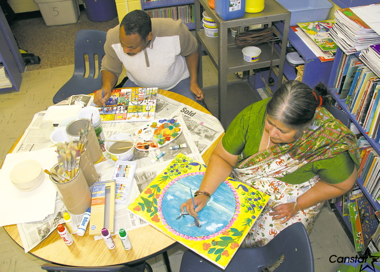Artists Isam Aboud (left) and Manju Lodha busy at work with their paintbrushes.