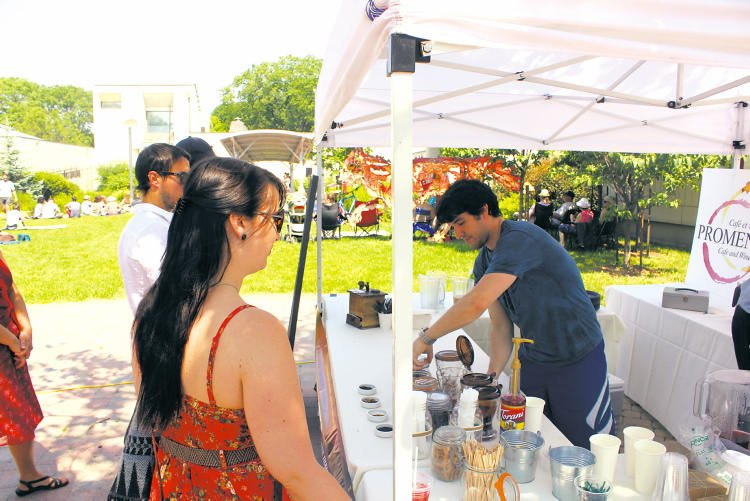 Staff from Promenade Café and Wine served up some tasty treats to visitors. Different restaurants will be catering the event throughout the summer.  (PHOTO COURTESY OF FESTIVAL DU VOYAGEUR)