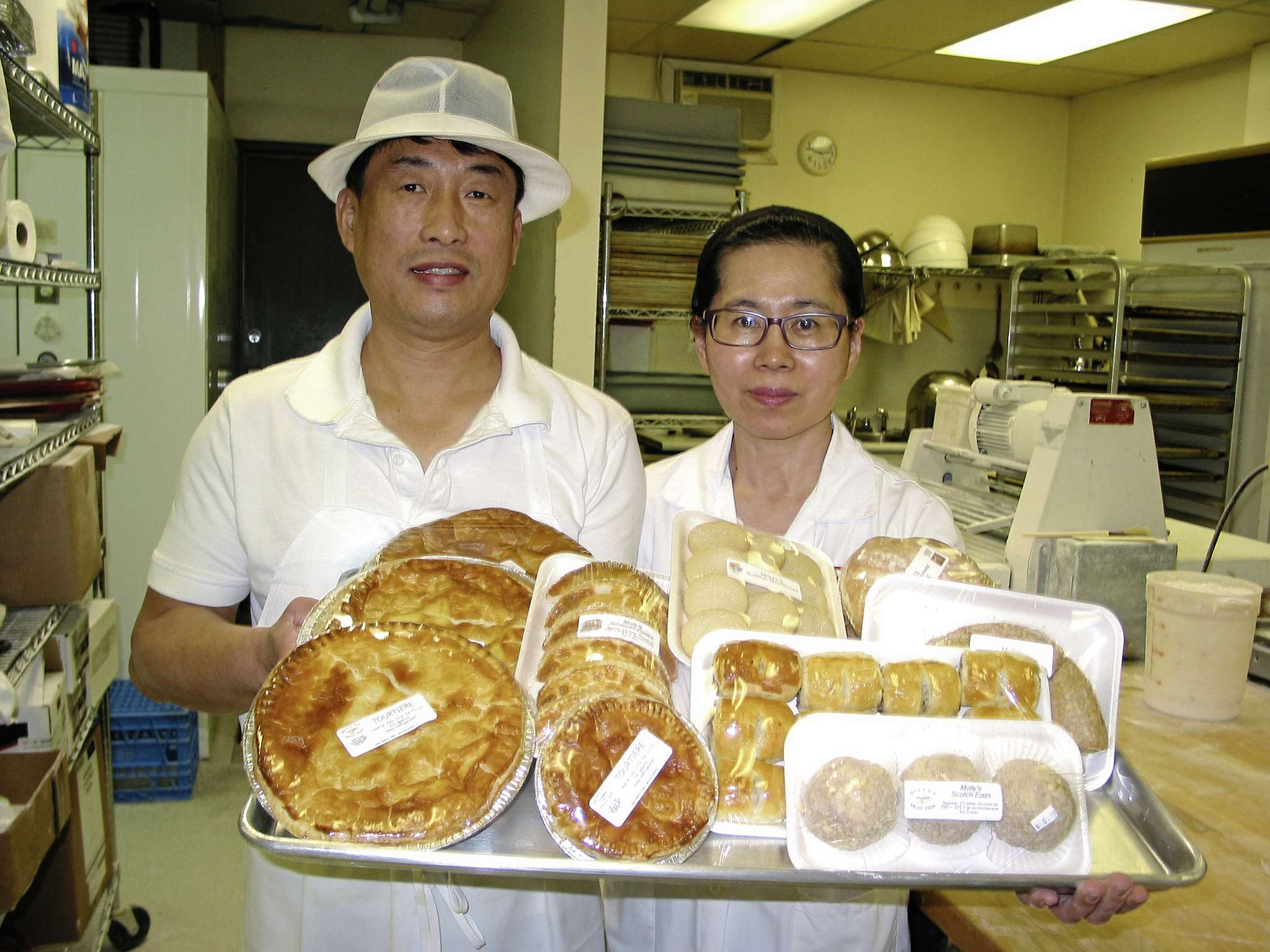 Ki Yong Park (left) and Claudia Kang celebrated three years as the owners of Molly's Meat Pies on Dec. 1.