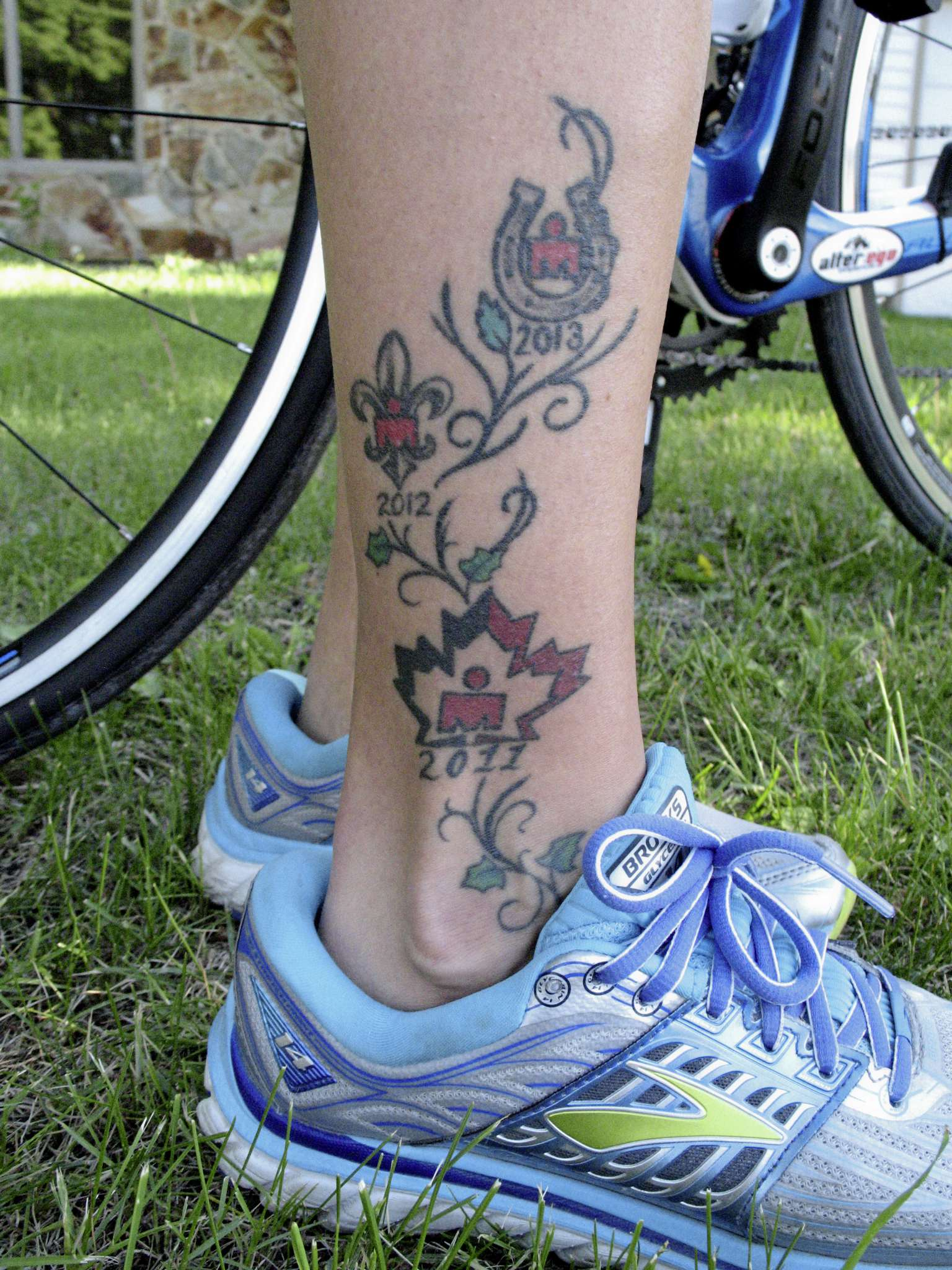 Elaine Ross has tattoos representing her appearances in Ironman competitions. (SIMON FULLER/CANSTAR NEWS/THE LANCE)