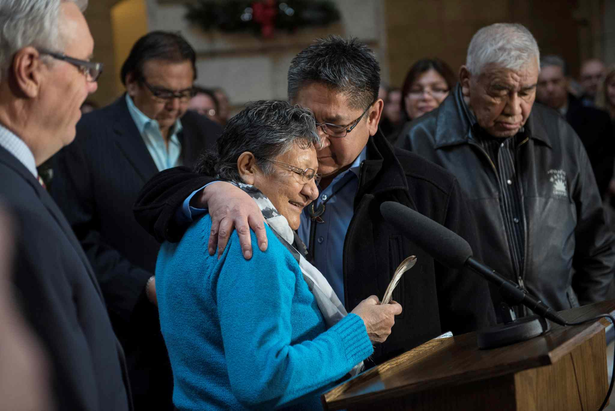 Elder Lilian Henry and Chief Erwin Redsky of Shoal Lake 40 First Nation embrace during the joint funding announcement at the Manitoba Legislature on Thursday.