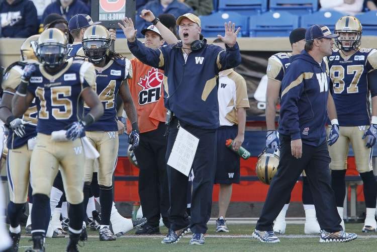 Winnipeg Blue Bombers head coach Paul LaPolice reacts on the bench during the first half of their CFL game against Hamilton Tiger-Cats in Winnipeg on Thursday, August 16.