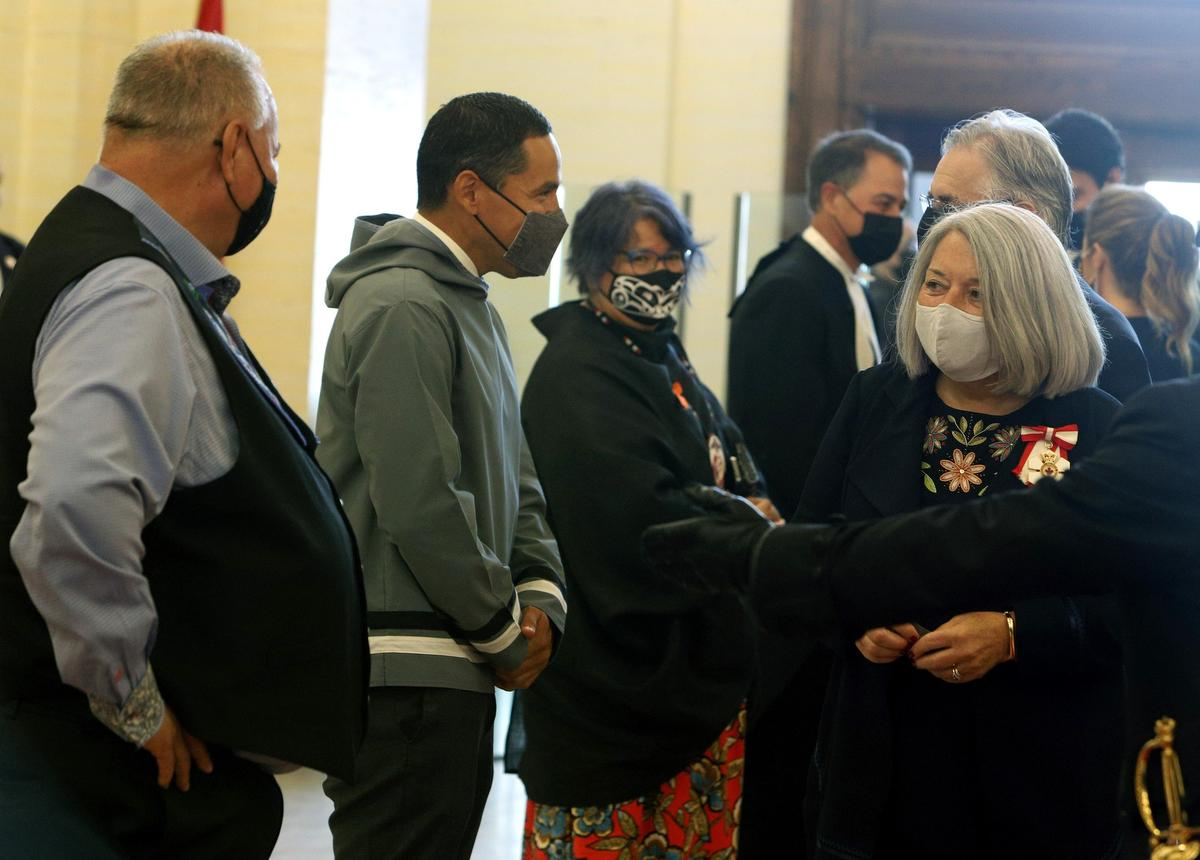 Mary Simon is greeted by David Chartrand (left), president of the Manitoba Metis Federation, Natan Obed (second left) of the Inuit Tapiriyt Kanatami and RoseAnne Archibald (centre) chief of the Assembly of First Nations as she makes her way to the Senate to be installed as the new governor general of Canada in Ottawa on Monday.
