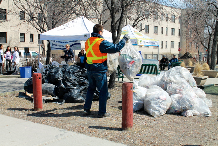 Recycling and garbage bags were being piled high at Saigon Park by lunchtime during the West End Biz's Sweeping Up spring clean event.