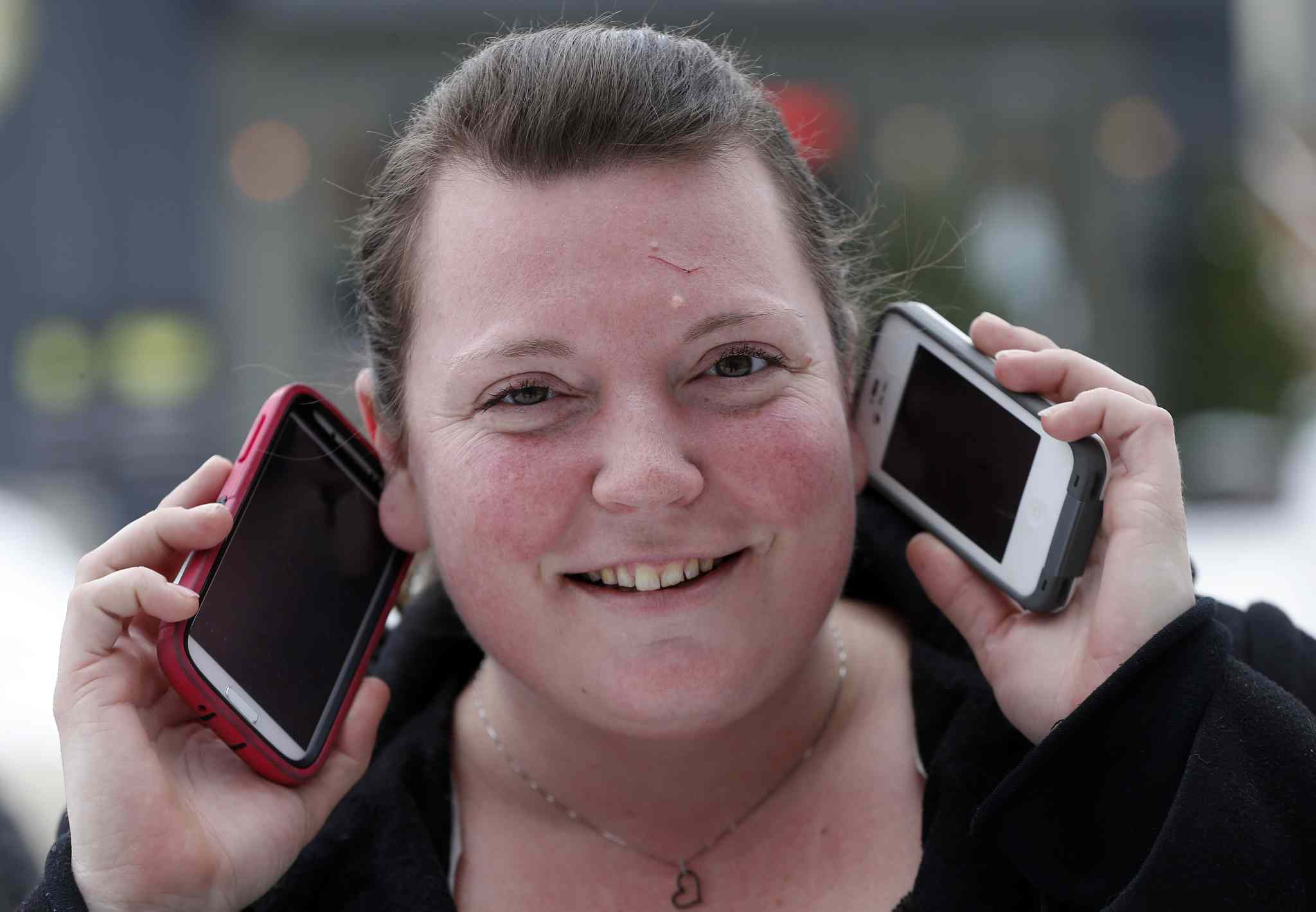 Marla Wojcik, 32, has two phones: one for work and one for personal use.  Nearly 50 per cent of Canadian mobile users say their device is on hand 24/7, according to a recent poll.