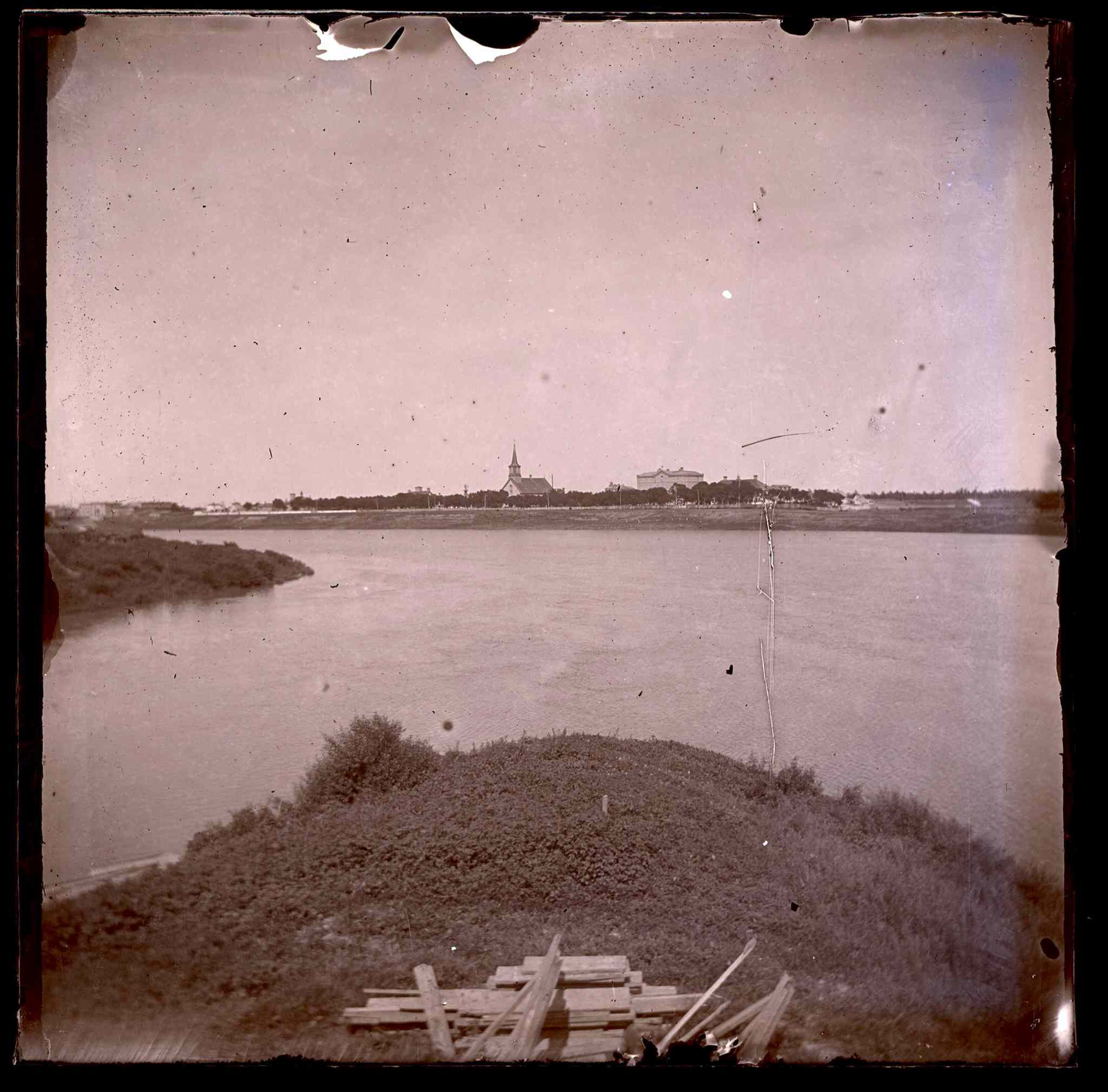 View from the Forks across the Red River at the original St.Boniface Cathedral on Taché before the basilica was built.