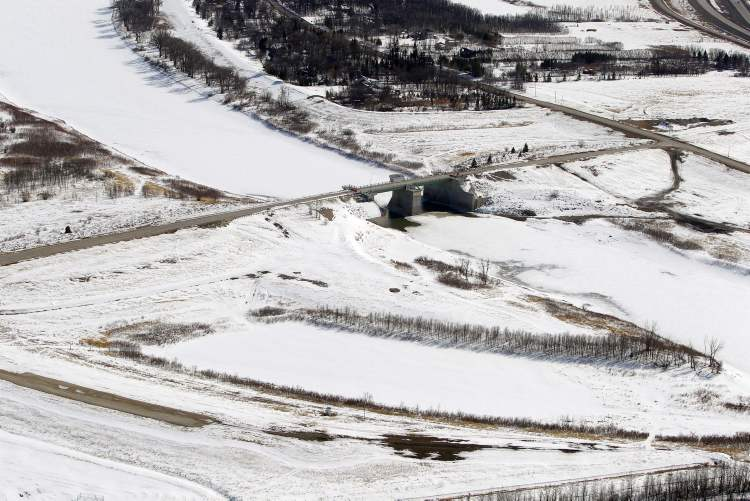 Aerial photo of the floodway gates south of Winnipeg along the Red River, April 10, 2013.  (Boris Minkevich / Winnipeg Free Press)