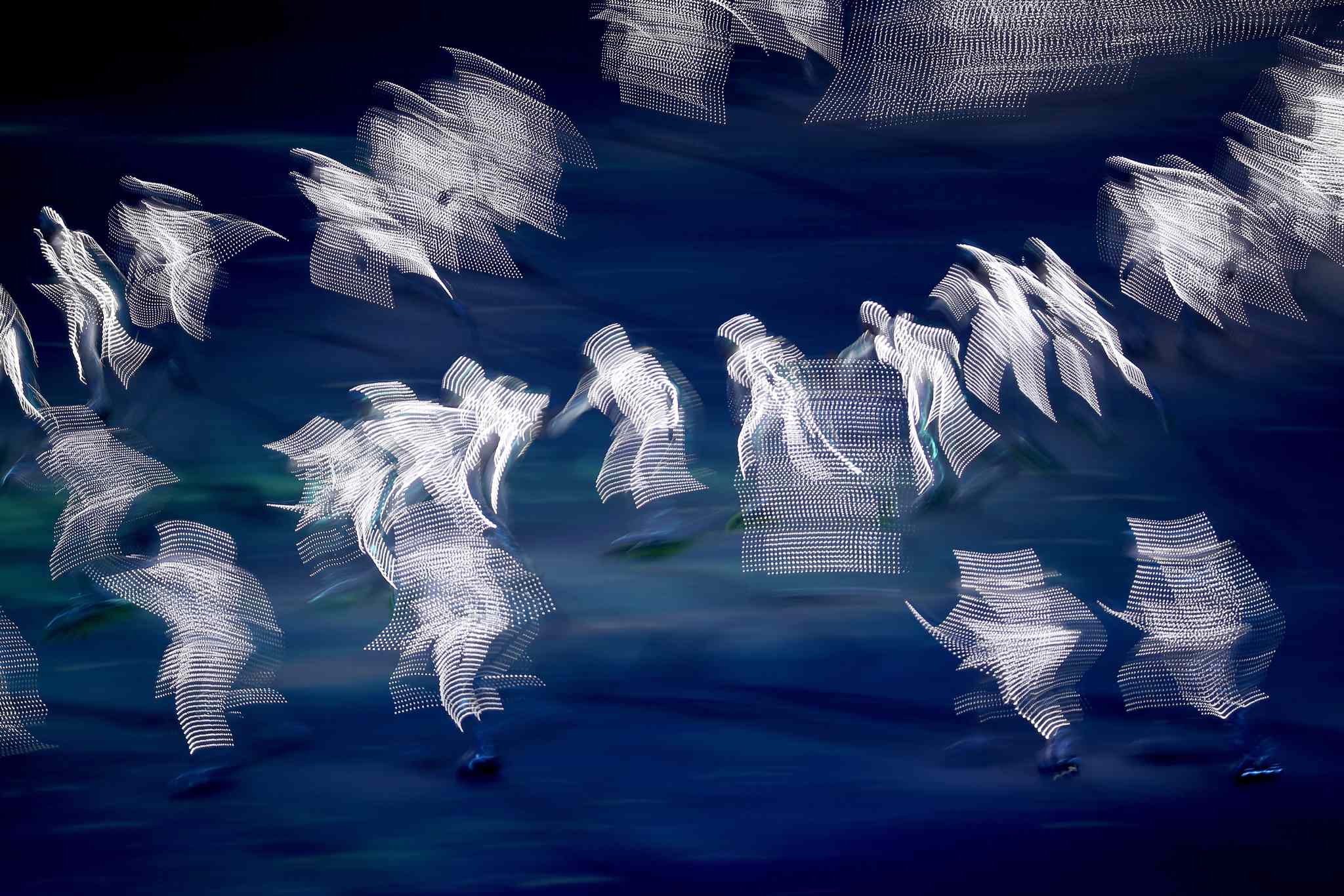 Illuminated dancers perform on roller skates during the Opening Ceremony for the Winter Olympics at Fisht Olympic Stadium in Sochi, Russia, Friday, Feb. 7, 2014. (Brian Cassella/Chicago Tribune/MCT)