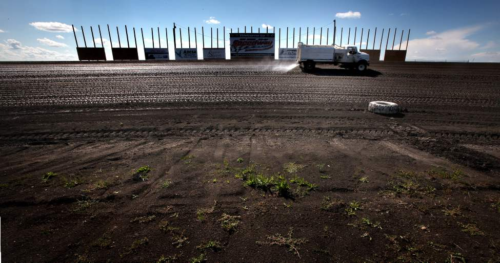 Track maintenance crews water and pack the mud oval into race conditions. Heat, wind, sun are all factors that affect the surface which drivers and pit crews will adapt to for the race.