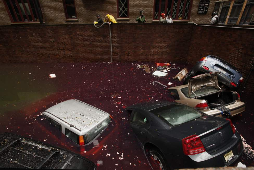 Cars float up from a car garage in a mixture of storm water and gasoline in lower Manhattan as workers begin the process of pumping out the mess, Tuesday, October 30, 2012. Hurricane Sandy caused major damage to New York City and surrounding areas. (Carolyn Cole/Los Angeles Times/MCT) (Tribune Media M)