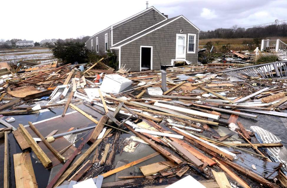 Debris floats around a house pushed off it's foundation in the aftermath of superstorm Sandy in East Haven, Conn., Tuesday, Oct. 30, 2012. Sandy, the storm that made landfall Monday, caused multiple fatalities, halted mass transit and cut power to more than 6 million homes and businesses. (AP Photo/Jessica Hill)