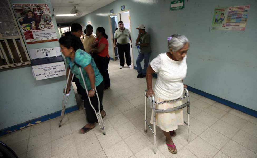 Patients on walkers and crutches arrive for an assessment clinic at Managua's Hospital Escuelda, Dr. Roberto Caulderon Gutierrez, where the Operation Walk team will perform knee replacements.
