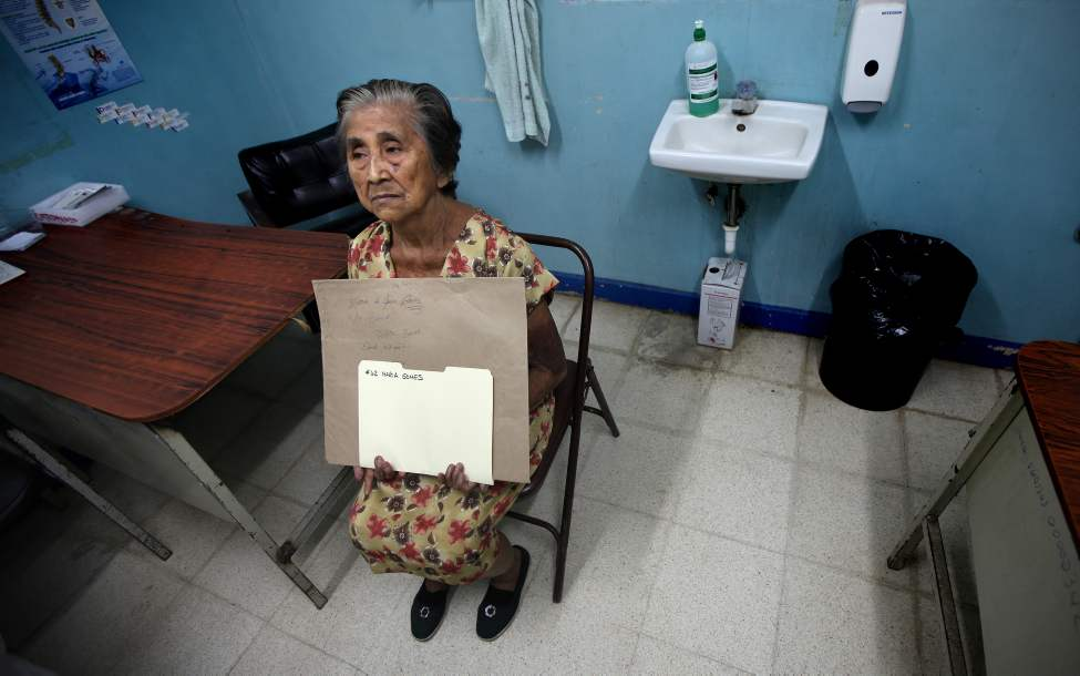 Surgical candidate Maria Gomez clutches her files and x-rays as she waits for an assessment by the Operation Walk team. Phil Hossack / Winnipeg Free Press October 25, 2012