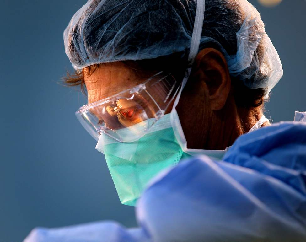 Operation Walk Surgeon David Heddon has his work reflected on a visor during knee replacement surgery in Managua. Phil Hossack / Winnipeg Free Press October 25, 2012