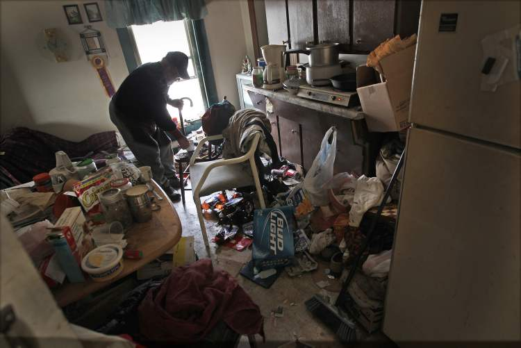 People who live in the shadows need to be heard. The use of ambient light in this July 25 photo of Joe Nemcshuk in a rooming house on Pritchard Avenue draws the viewer in to see what lies within those shadows.