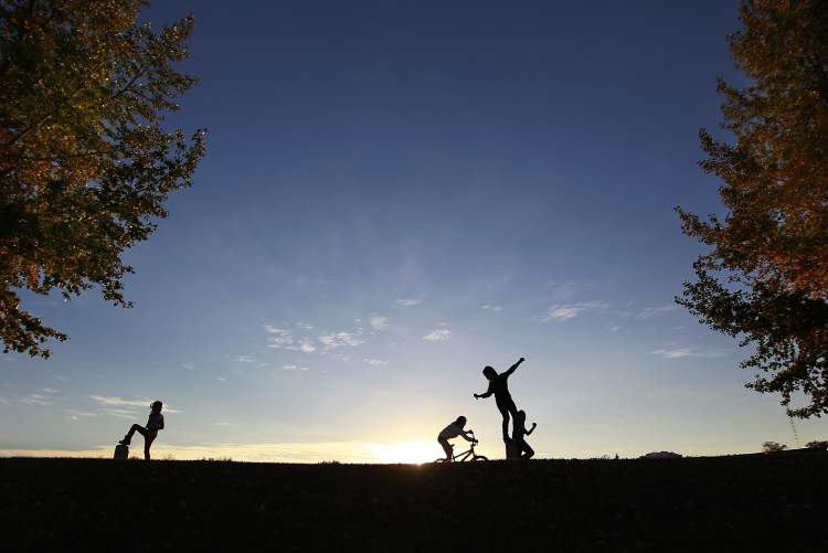 Children from the Little Saskatchewan First Nation play at Misty Lake Lodge Oct. 1. The open sky in this photo conveys  an uninhibited freedom for these children to play in. (John Woods / Winnipeg Free Press)