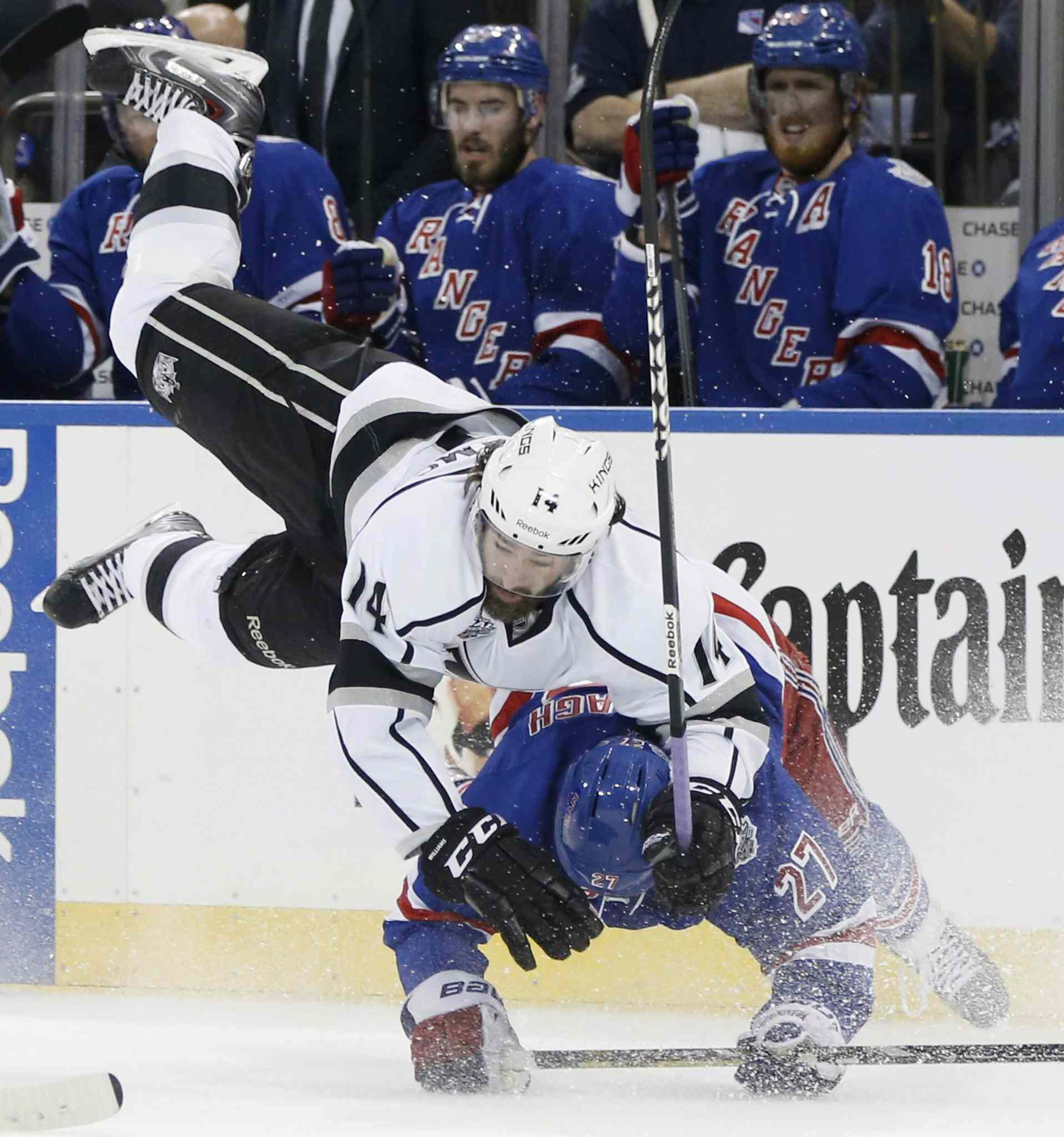 Los Angeles Kings' right wing Justin Williams (14) collides with New York Rangers' defenceman Ryan McDonagh (27) in the first period during Game 4 of the NHL hockey Stanley Cup Final on Wednesday in New York.