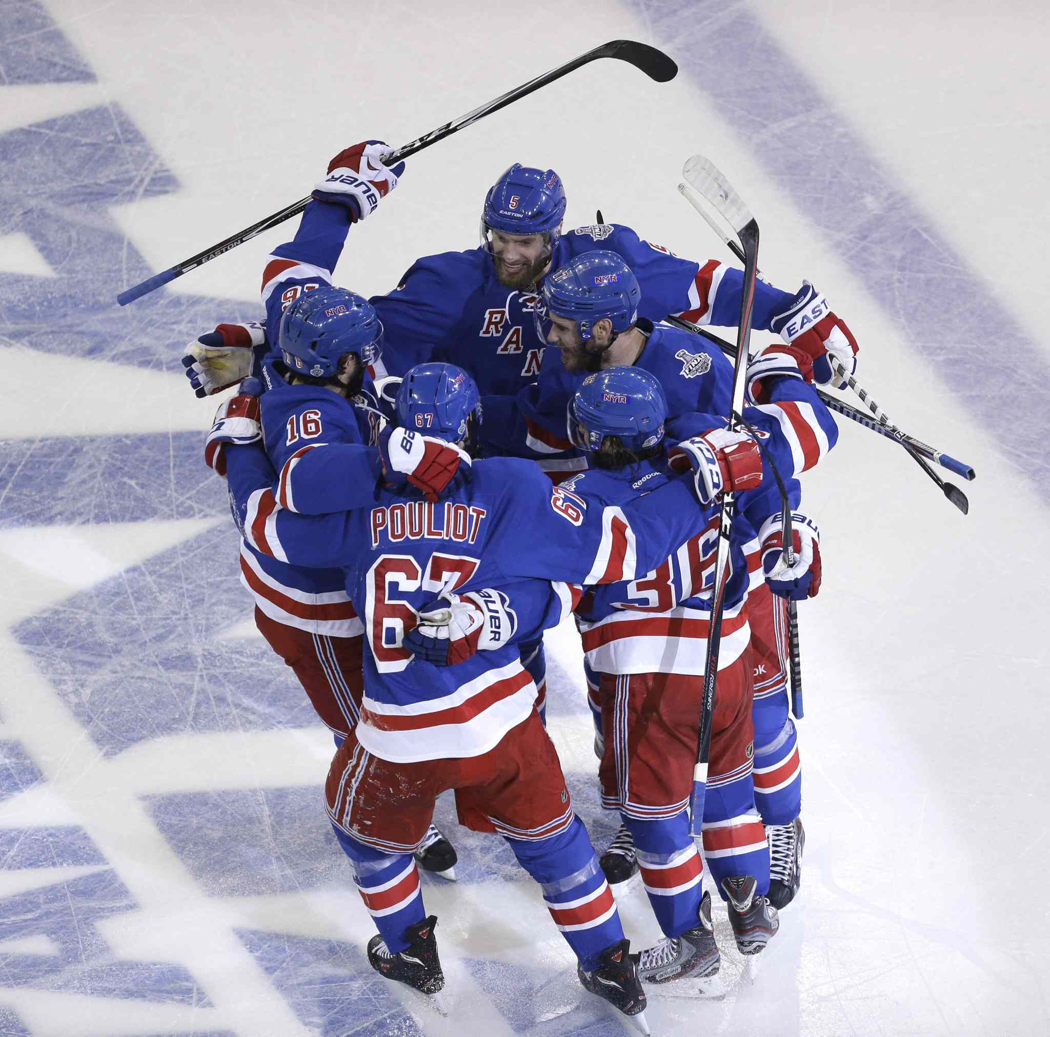 New York Rangers' left wing Benoit Pouliot (67) celebrates with teammates after scoring a first-period goal during Game 4 against the Los Angeles Kings on Wednesday.