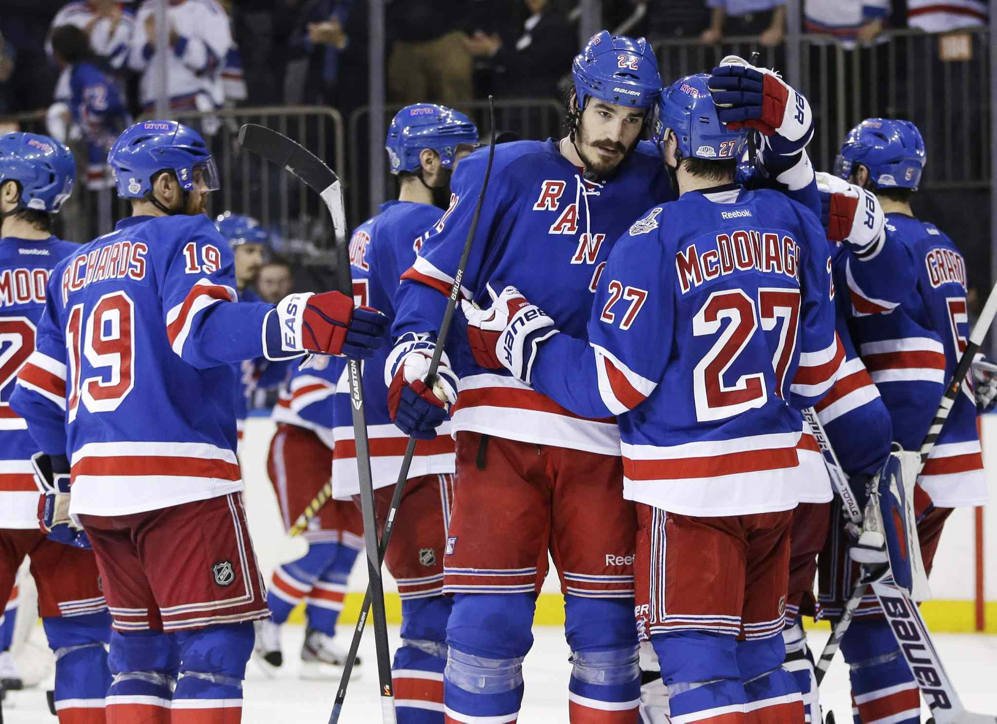 New York Rangers center Brian Boyle (22), center, greets defenseman Ryan McDonagh (27) after the Rangers beat the Los Angeles Kings Wednesday.
