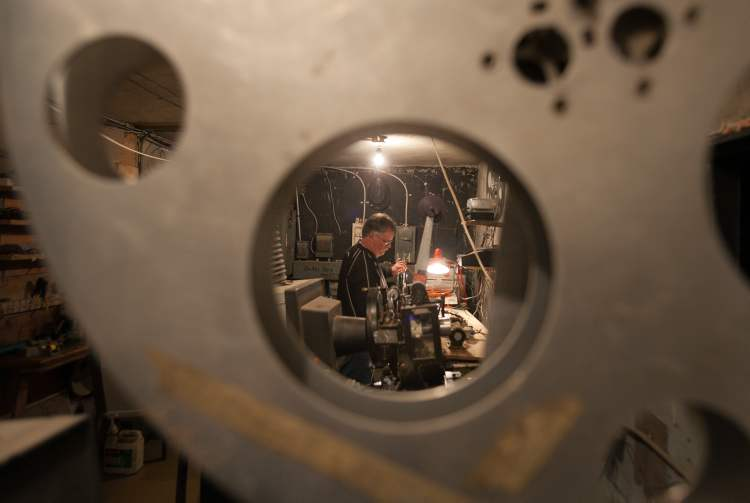 Terry Nelson works in the projection room at the Stardust Drive-In theatre in Morden. (Melissa Tait / Winnipeg Free Press)