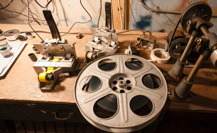 A film reel and splicing equipment in the projection room at the Stardust Drive-In theatre in Morden. (Melissa Tait / Winnipeg Free Press)