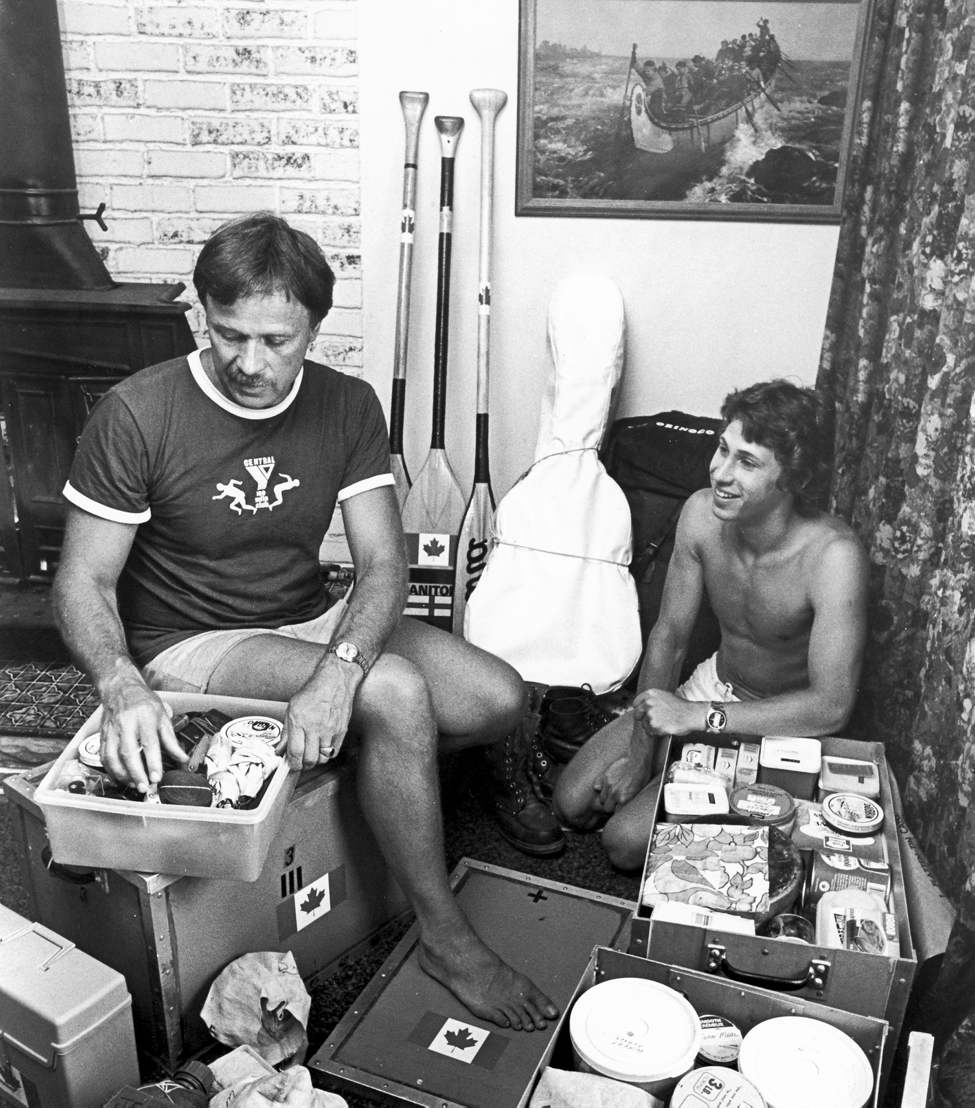 Don Starkell and son Dana go over their equipment prior to leaving on a two-year canoe trip to South America. Starkell and his two sons travelled through 12 countries on the trip from Winnipeg to Brazil. 1980.