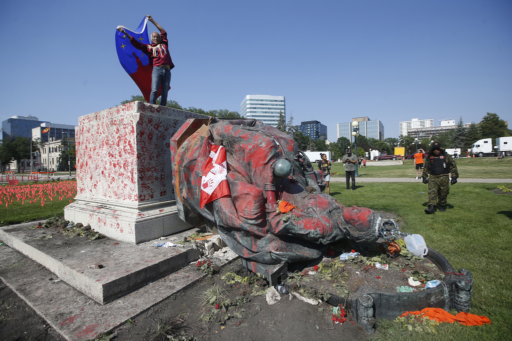 A statue of Queen Victoria was toppled at the Manitoba Legislative Building following a march in honour of Indigenous children found in unmarked graves at former residential schools. (John Woods / Winnipeg Free Press)