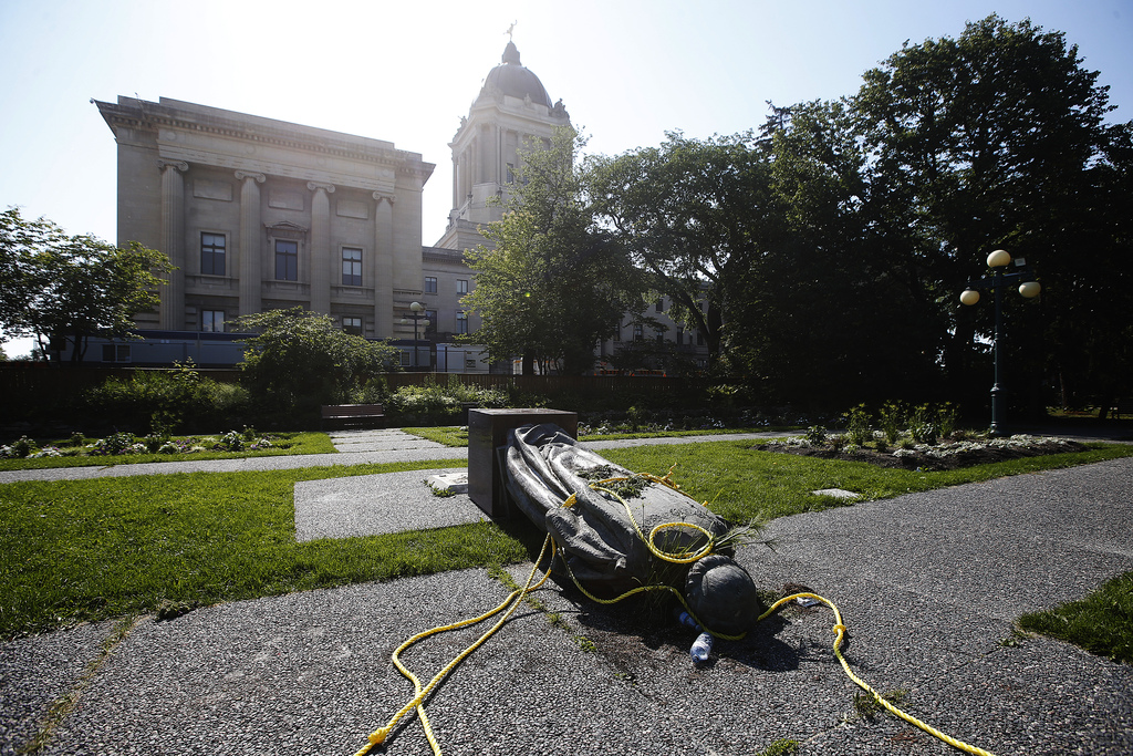 A statue of Queen Elizabeth on the grounds of Government House, the official residence of the lieutenant-governor, was also toppled. (John Woods / Winnipeg Free Press)